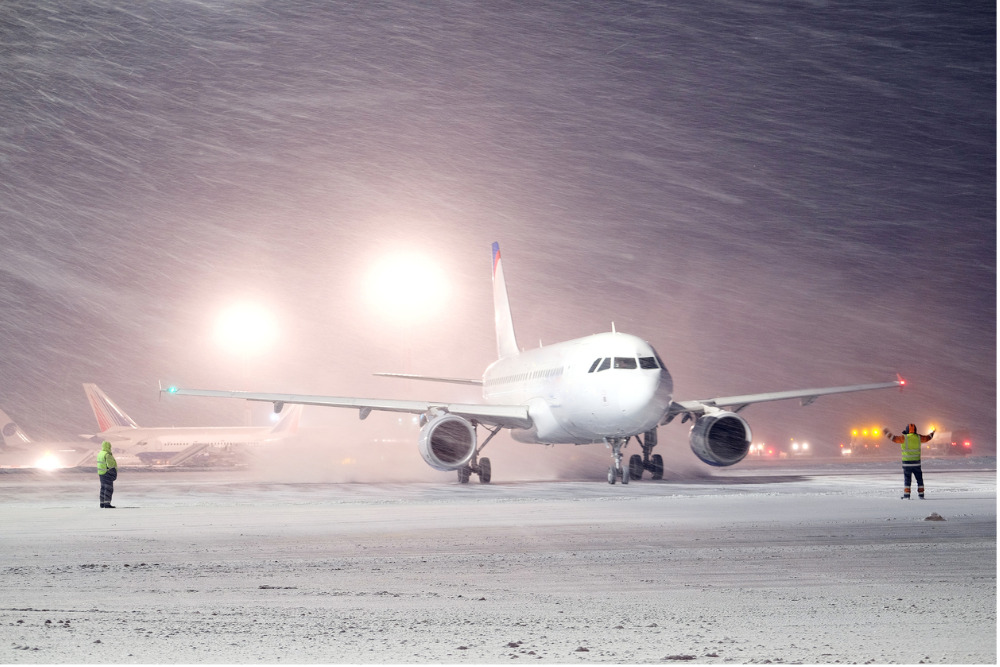 plane parked at the airport in winter picture id4844764702